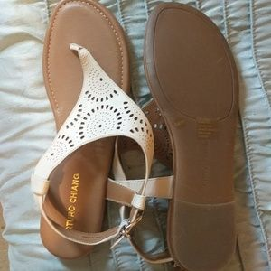 Tan sandals with white leather strap